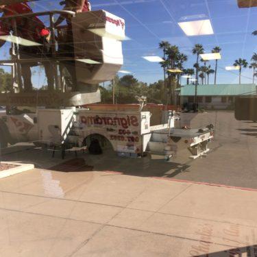Storefront glass graffiti repair before